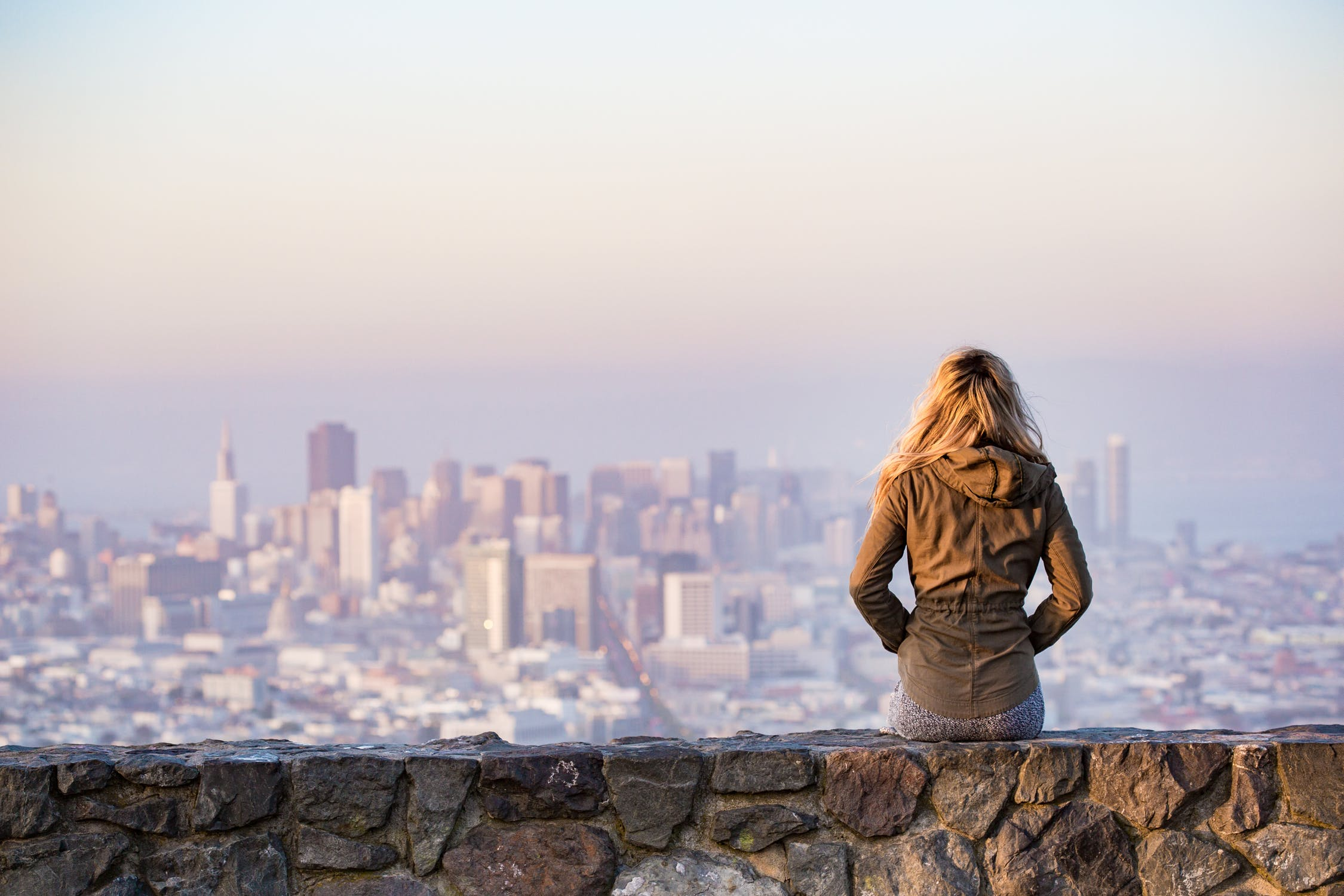 Young woman alone staring at the city